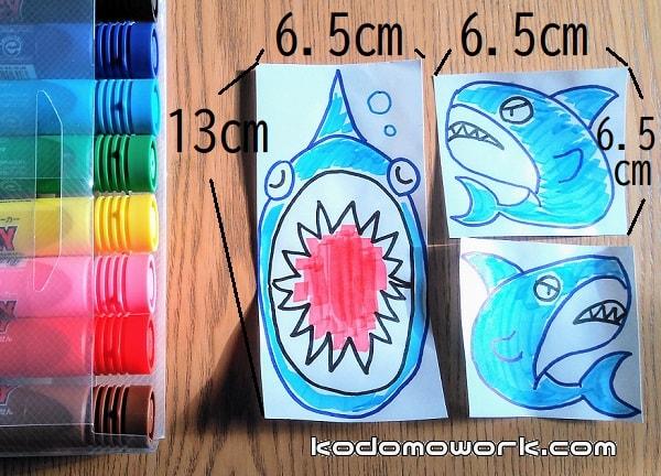 魚の絵を3枚描く。13×6.5㎝口をあけて寝てるサメ、6.5×6.5㎝サメ左、6.5×6.5㎝サメ右