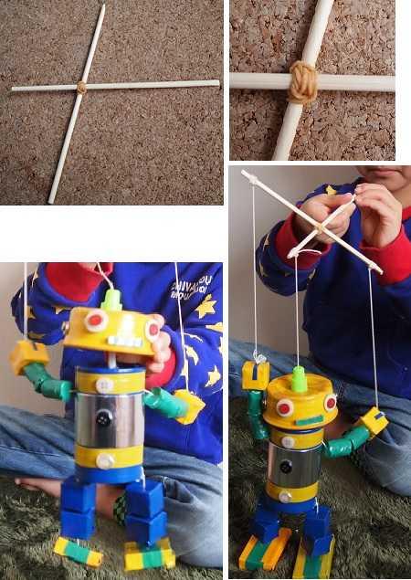 わりばしを操ってとマリオネットで遊ぶ小学生